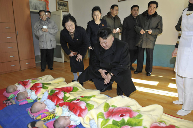 North Korean leader Kim Jong Un visits an orphanage in this undated photo released by North Korea's Korean Central News Agency (KCNA) in Pyongyang February 4, 2014. (Photo by Reuters/KCNA)
