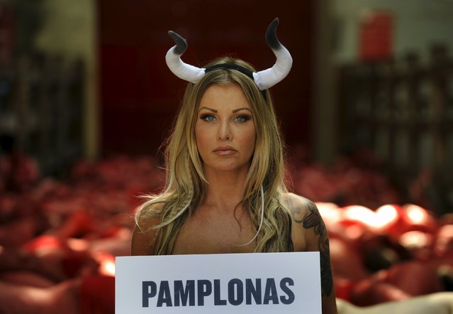 An animal rights protester demonstrates for the abolition of bull runs and bullfights, three days before the start of the famous running of the bulls San Fermin festival in Pamplona, northern Spain, July 4, 2015. (Photo by Eloy Alonso/Reuters)