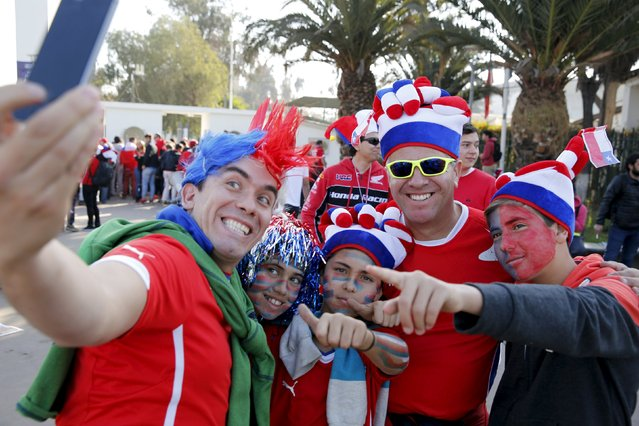 Chilean soccer fans take a selfie ahead of the Copa America 2015 final soccer match between Chile and Argentina in Santiago, Chile, July 4, 2015. (Photo by Andres Stapff/Reuters)