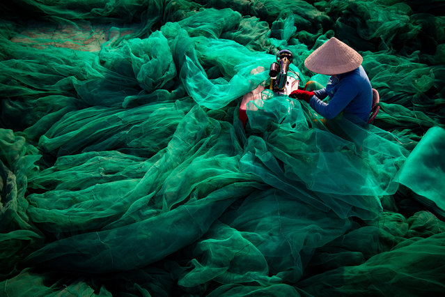 Sewing Net by Tran Tuan Viet, Phu Yen, Vietnam. As fish stocks decrease fishing methods become increasingly extreme. Destructive fishing with small-hole nets devastate the marine environment. (Photo by Tran Tuan Viet/CIWEM Environmental Photographer of the Year 2019)