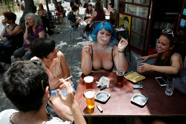 "Protesters sit in a cafe during a ""SlutWalk"" protest, in which several hundred participants march through the centre of Jerusalem, May 13, 2016. (Photo by Amir Cohen/Reuters)"