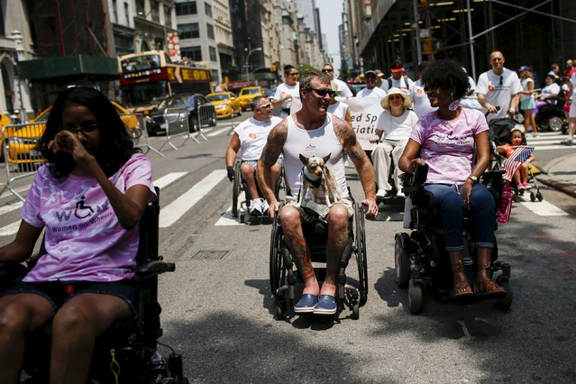 People with disabilities take part in the disability pride parade in New York, July 12, 2015. (Photo by Eduardo Munoz/Reuters)