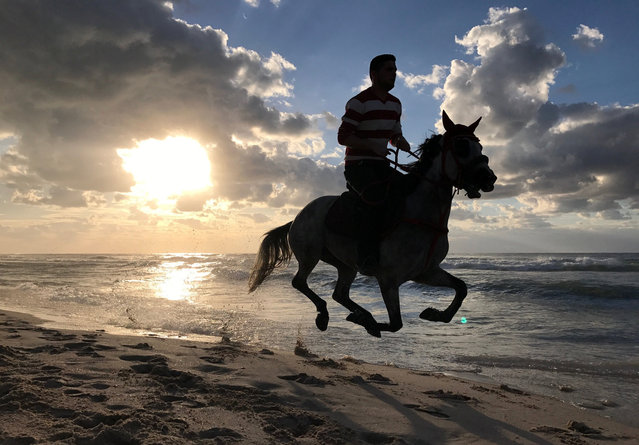 A Palestinian man rides his horse on a beach in Gaza City February 17, 2017. (Photo by Mohammed Salem/Reuters)