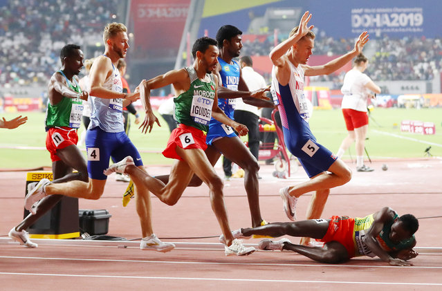 Teddese Lemi of Ethiopia falls as Filip Ingebrigtsen of Norway and others compete in the Men's 1500 Metres heats during day seven of 17th IAAF World Athletics Championships Doha 2019 at Khalifa International Stadium on October 03, 2019 in Doha, Qatar. (Photo by Michael Steele/Getty Images)