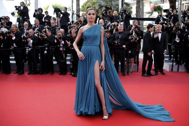 "Model Ana Beatriz Barros poses on the red carpet as she arrives for the screening of the film ""La fille inconnue"" (The Unknown Girl) in competition at the 69th Cannes Film Festival in Cannes, France, May 18, 2016. (Photo by Jean-Paul Pelissier/Reuters)"