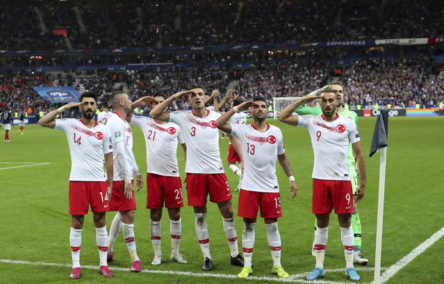 Turkey's players salute as they celebrate a goal against France during the Euro 2020 group H qualifying soccer match between France and Turkey at Stade de France at Saint Denis, north of Paris, France, Monday, October 14, 2019. (Photo by Thibault Camus/AP Photo)