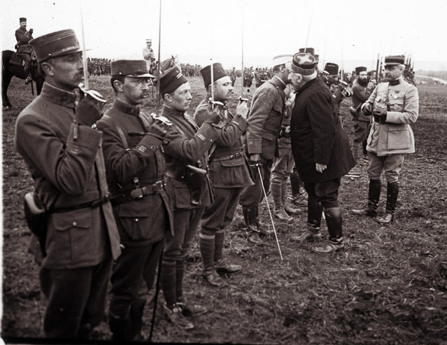 An archive picture shows French General Joseph Joffre (2nd R) congratulating and awarding medals to soldiers, who fought in the Battle of Verdun, in Verdun March 1916. (Photo by Collection Odette Carrez/Reuters)