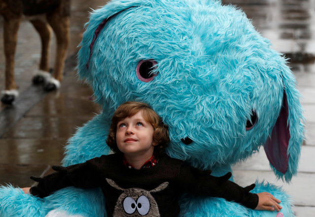 Winston Bartlett, 9, poses for a photograph with a giant Scruff-a-luvs toy at Hamleys store, ahead of announcing their top-ten Christmas toys, in London, Britain, September 26, 2019. (Photo by Peter Nicholls/Reuters)