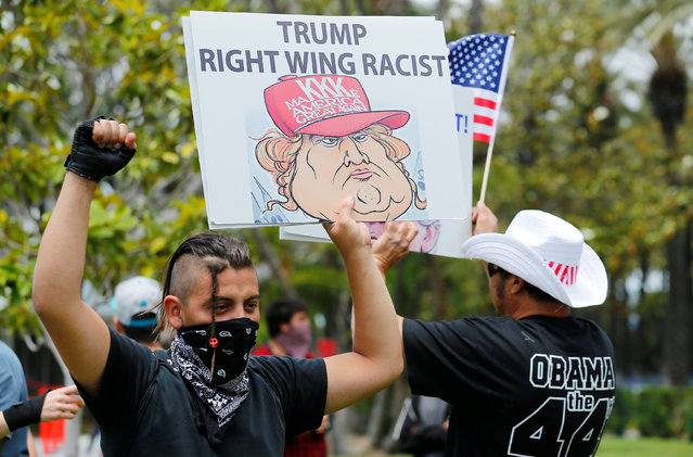 Anti-Trump demonstrators protests outdoors before U.S. Republican presidential candidate Donald Trump speaks at a campaign event in Anaheim, California, U.S., May 25, 2016. (Photo by Mike Blake/Reuters)