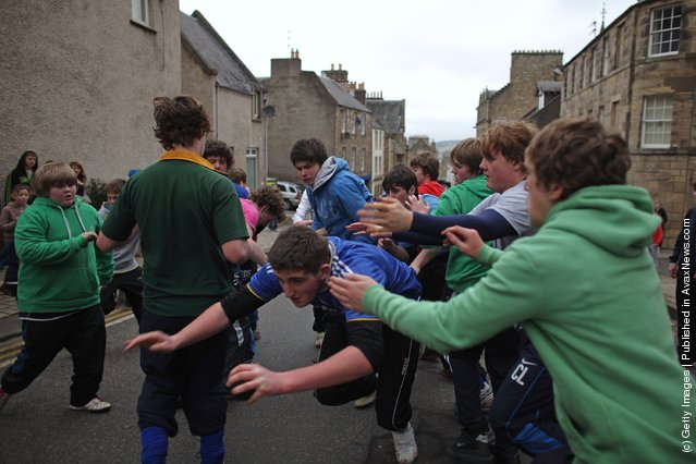 Youths tussle for the leather ball during the annual 'Fastern Eve Handba' event in Jedburgh's High Street in the Scottish Borders in Jedburgh