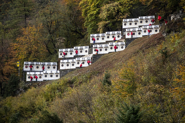 Helpers at the targets at the traditional 157th Ruetlischiessen on the Ruetli at the Vierwaldstaettersee, Switzerland on Wednesday, November 6, 2019. (Photo by Alexandra Wey/Keystone)