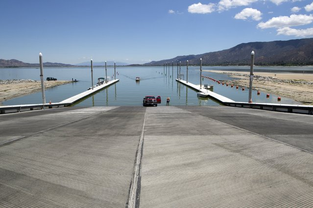 Boat launch dock pilings at La Laguna Resort stand high over the receded waters of Lake Elsinore in Lake Elsinore, California July 23, 2015. (Photo by David McNew/Reuters)