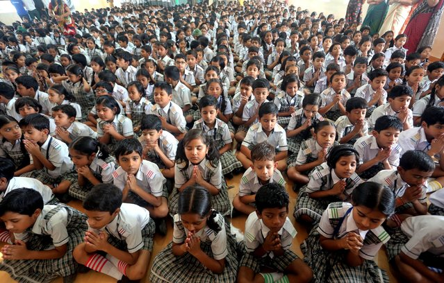 Indian school children gather for a prayer for late Indian former President APJ Abdul Kalam, July 28, 2015, as they pay their respect at a school in Bhopal, India. (Photo by Sanjeev Gupta/EPA)