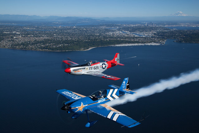Air National Guard and the Heritage Flight Museum's P-51 Mustang takes to the skies at Seafair 2015 on Thurs., July 30, 2015 in Seattle, Wash. (Photo by Matt Mills McKnight/Invision for John Klatt Airshows, Inc./AP Images)