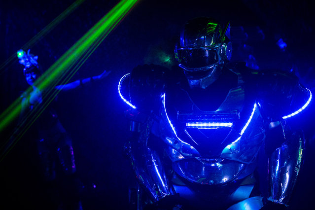 A performer dressed as a Robot is seen during a show at The Robot Restaurant on June 29, 2014 in Tokyo, Japan. The now famous Robot Restaurant opened two years ago in Kabukicho area of Shinjuku at an estimated cost of 10 million U.S. dollars. Performances are held three times a day and cater mostly to foreign tourists. (Photo by Chris McGrath/Getty Images)