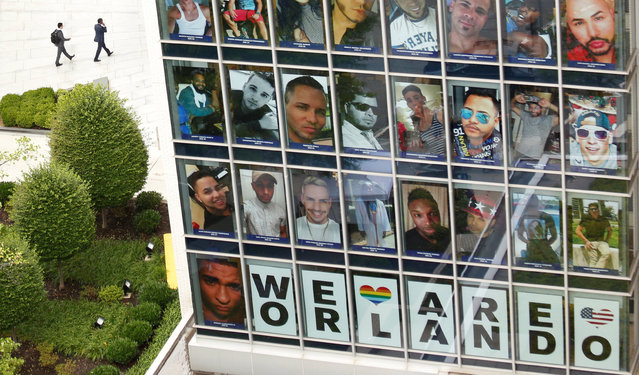 "Photos of the 49 killed in the Orlando night club shooting and a sign saying ""We Are Orlando"" fill the windows of the Human Rights Campaign office in Washington June 17, 2016. (Photo by Kevin Lamarque/Reuters)"