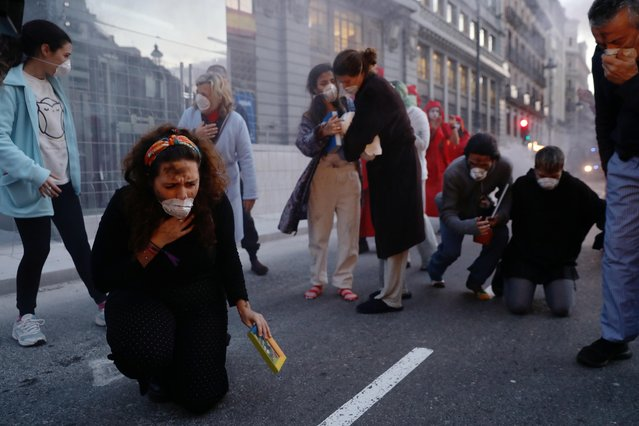 Extinction Rebellion members perform as they demonstrate over Australia's bushfires crisis in Madrid, Spain on January 16, 2020. (Photo by Susana Vera/Reuters)