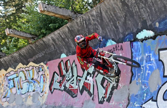 Downhill bikers Kemal Mulic trains on the disused bobsled track from the 1984 Sarajevo Winter Olympics on Trebevic mountain near Sarajevo, Bosnia and Herzegovina, August 8, 2015. (Photo by Dado Ruvic/Reuters)
