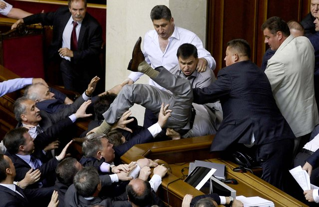 Lawmakers from pro-presidential and oppositional factions  in the parliament session hall in Kiev, Ukraine on May 24, 2012