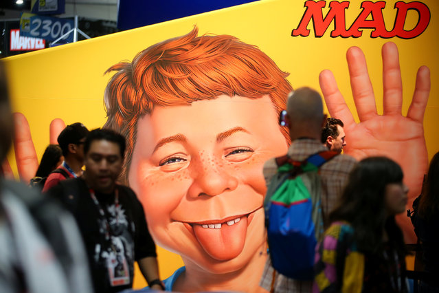Comic Con fans walk past a MAD poster as they participate in the opening preview night  at Comic Con International in San Diego,California, U.S., July 19, 2017. (Photo by Mike Blake/Reuters)