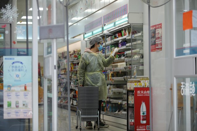 A worker is seen inside a convenience store following an outbreak of the novel coronavirus in Wuhan, Hubei province, February 11, 2020. (Photo by Reuters/China Stringer Network)