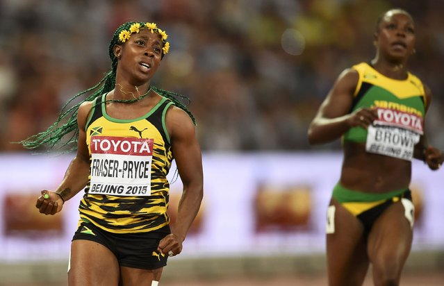 Shelly-Ann Fraser-Pryce of Jamaica (L) celebrates winning the women's 100 metres final ahead of Veronica Campbell-Brown of Jamaica during the 15th IAAF World Championships at the National Stadium in Beijing, China August 24, 2015. (Photo by Dylan Martinez/Reuters)