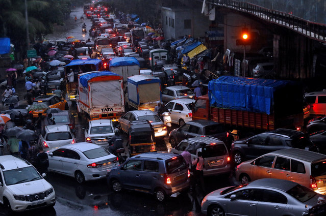 Vehicles are seen stuck in a traffic jam at an intersection after rains in Mumbai, August 29, 2017. (Photo by Shailesh Andrade/Reuters)