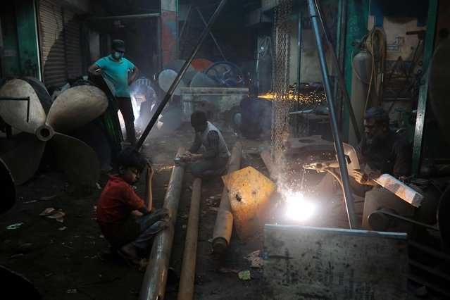 Men and children work in a dockyard in Dhaka, Bangladesh, March 7, 2020. (Photo by Mohammad Ponir Hossain/Reuters)