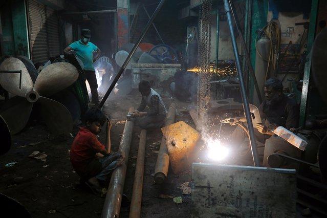 Men and children work in a dockyard in Dhaka, Bangladesh, March 7, 2020. (Photo by Mohammad Ponir Hossain/Reuters)