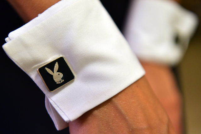 A Playboy Bunny shows her cufflinks as she prepares herself before starting work at the Playboy Club on July 26, 2016 in London, England. (Photo by Carl Court/Getty Images)