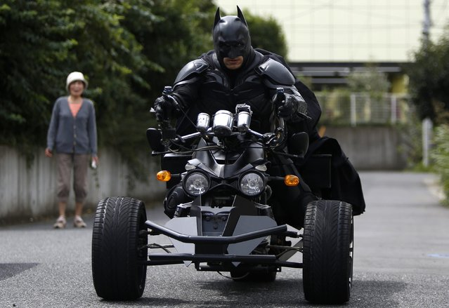 """A 41-year-old man going by the name of Chibatman leaves his home on his """"Chibatpod"""" in Chiba, east of Tokyo, August 31, 2014. (Photo by Yuya Shino/Reuters)"""