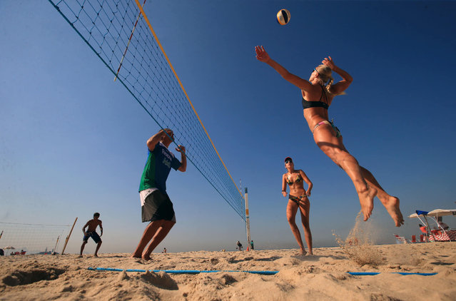 People play volleyball on Copacabana beach ahead of the Rio Olympic Games, Brazil on Tuesday August 2, 2016. (Photo by Mike Egerton/PA Wire)