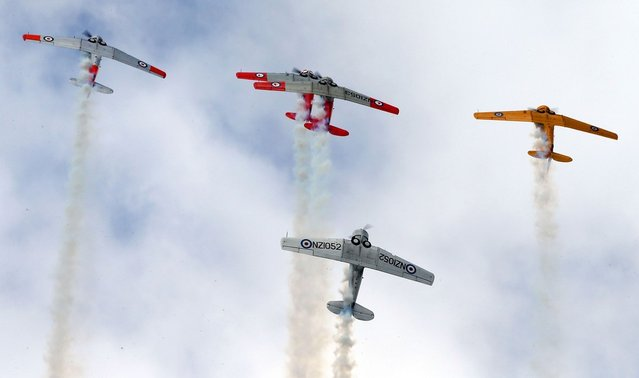 The Roaring 40's Harvard display team perform during an airshow commemorating the rebuild of Havilland Mosquito KA 114, on September 29, 2012 in Ardmore, New Zealand. The plane was restored by Warbird Restorations at Ardmore Aerodrome and is the only flying Mosquito in the world.  (Photo by Simon Watts)