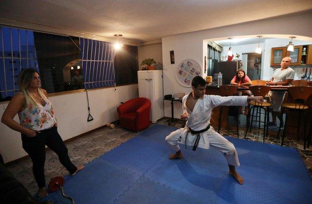 Venezuela team karateka Ricardo Perez during a training session at home with his family, following the outbreak of the coronavirus disease (COVID-19), Caracas, Venezuela, May 8, 2020. (Photo by Manaure Quintero/Reuters)