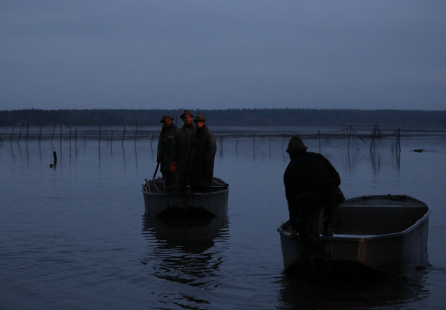 Fishermen prepare for a traditional fish haul on the Horusicky pond near the town of Veseli nad Luznici, Czech Republic, Tuesday, October 24, 2017. Each autumn, Czech fishermen get to serious business of a century-long tradition of catching carp for Christmas markets. Southern Bohemia, where the Horusicky pond is located, with its elaborate network of ponds is at the center of the local carp universe. (Photo by Petr David Josek/AP Photo)
