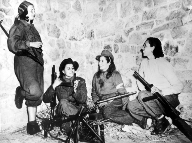 Female Italian partisans in Castelluccio, Italy, keep weapons ready as they wait for their turn to patrol with the U.S. 5th Army on February 11, 1944. (Photo by AP Photo)