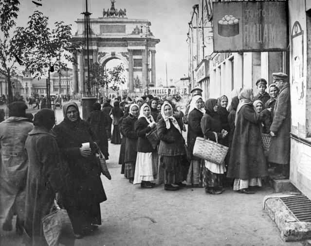 In this photo taken in October 1917, provided by Russian State Documentary Film and Photo Archive, people line up to get food at Tverskaya Zastava, in Moscow, Russia. The 1917 Bolshevik Revolution was long before the digital revolution allowed anyone to instantly document events. But the clumsy cameras of the time still caught some images that capture the period's drama. (Photo by Russian State Documentary Film and Photo Archive via AP Photo)