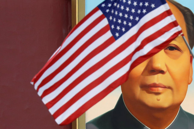 A U.S. flag flutters in front of a portrait of the late Chinese Chairman Mao Zedong at Tiananmen gate during the visit by U.S. President Donald Trump to Beijing, China, November 8, 2017. (Photo by Damir Sagolj/Reuters)