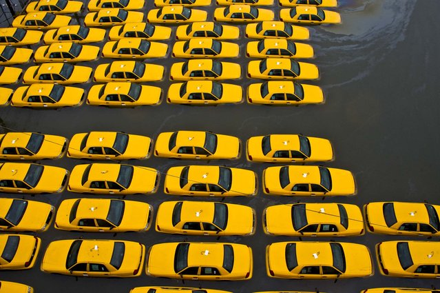 A parking lot full of yellow cabs in Hoboken, New Jersey. (Photo by Charles Sykes/Associated Press)
