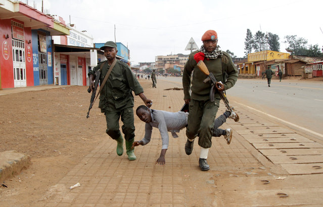 Congolese soldiers arrest a civilian protesting against the government's failure to stop the killings and inter-ethnic tensions in the town of Butembo, in North Kivu province, Democratic Republic of Congo, August 24, 2016. (Photo by Kenny Katombe/Reuters)