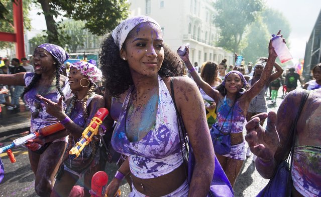 Revellers take part in the Children's Day parade of the Notting Hill Carnival in London, Britain, 28 August 2016. The street festival celebrates this year its 52nd anniversary and more than a million people are expected to attend on 28 and 29 August. (Photo by Will Oliver/EPA)