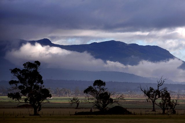 Clouds form above farmland in Tasmania's northwest on the outskirts of Launceston in this file picture taken on June 4, 2014. (Photo by David Gray/Reuters)