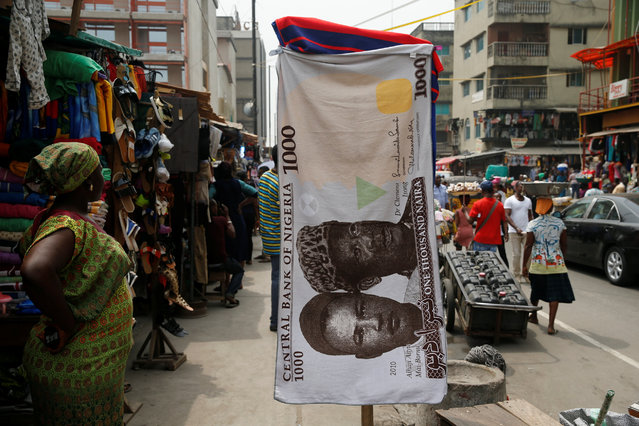 A towel with a print of the Nigerian naira is displayed for sale at a street market in the central business district in Nigeria's commercial capital Lagos February 4, 2016. (Photo by Akintunde Akinleye/Reuters)