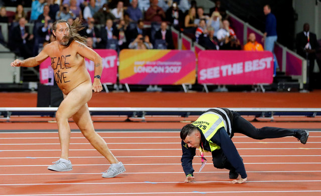 A streaker is chased by a steward after invading the track during the World Athletics Championships in London, August 5, 2017. (Photo by Kai Pfaffenbach/Reuters)