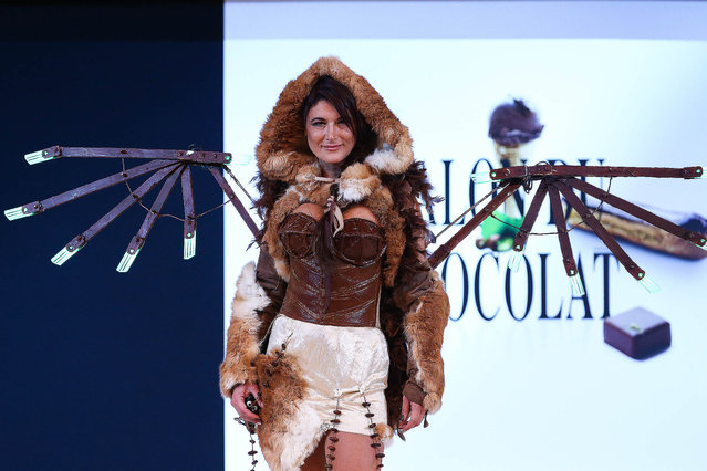 Marion Dumas walks the runway and wears a chocolate dress made by stylist Valerie Pache and chocolate maker Stephane Bonnat during the Fashion Chocolate show at Salon du Chocolat at Parc des Expositions Porte de Versailles on October 28, 2014 in Paris, France.  (Photo by Richard Bord/Getty Images)