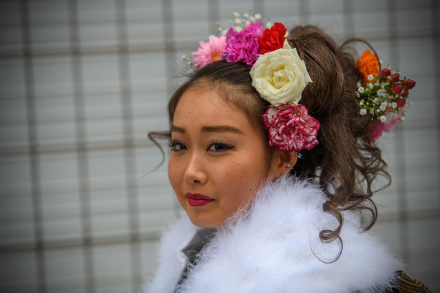 A woman poses for a photograph after attending a Coming of Age ceremony on January 8, 2018 in Yokohama, Japan. (Photo by Carl Court/Getty Images)