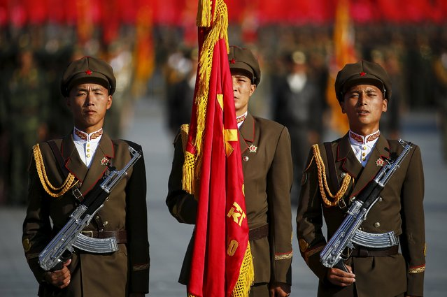 North Korean soldiers stand guard at the beginning of the parade celebrating the 70th anniversary of the founding of Workers' Party of Korea in Pyongyang October 10, 2015. (Photo by Damir Sagolj/Reuters)