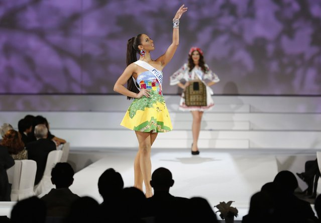 Valerie Hernandez Matias representing Puerto Rico, poses in national dress during the 54th Miss International beauty pageant in Tokyo November 11, 2014. Matias won the Miss International title. (Photo by Thomas Peter/Reuters)
