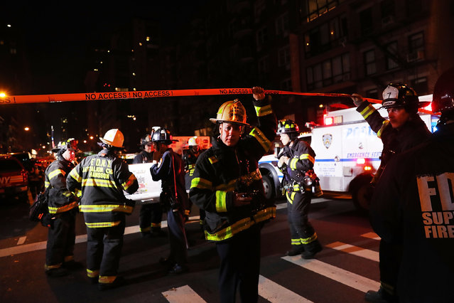 Police, firefighters and emergency workers gather at the scene of an explosion in Manhattan on September 17, 2016 in New York City. The evening explosion at 23rd street in the popular Chelsea neighborhood injured over a dozen people and is being investigated. (Photo by Spencer Platt/Getty Images)