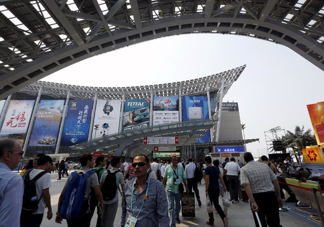 Visitors walk between venues of the China Import and Export Fair, also known as Canton Fair, in the southern Chinese city of Guangzhou October 15, 2015. (Photo by Bobby Yip/Reuters)